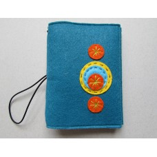 Teal felt notebook cover with circle design