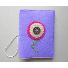 Lilac cover with a pink flower design